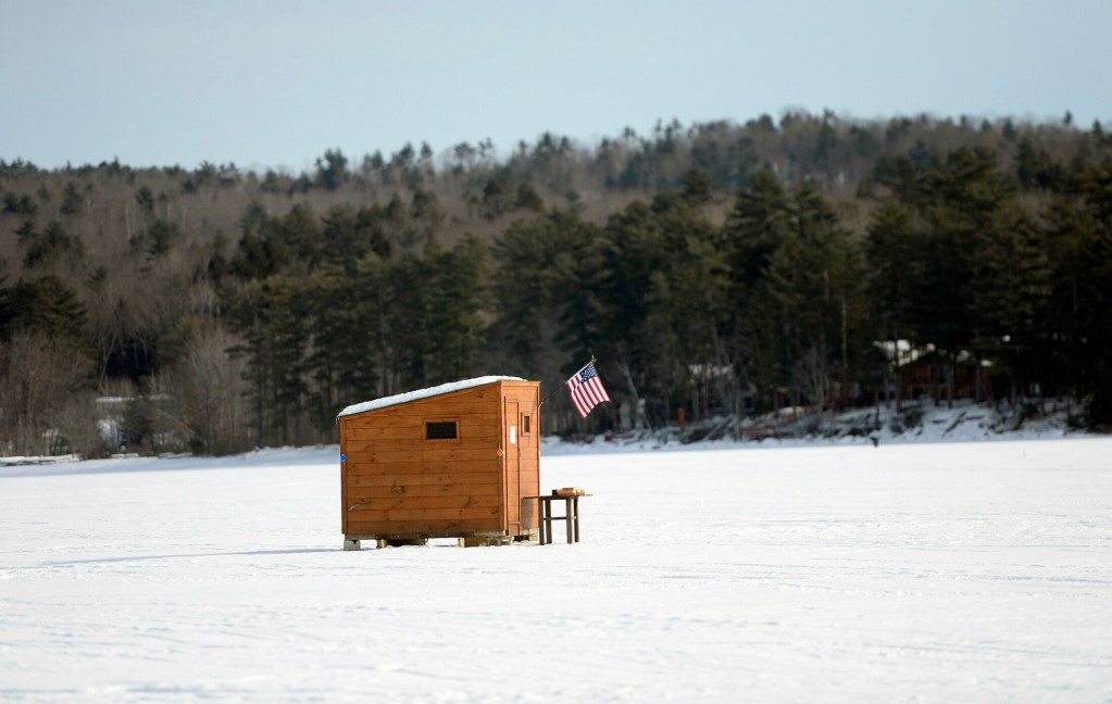 A traditional ice fishing shack on Long Lake in Naples Saturday, January 19, 2019.