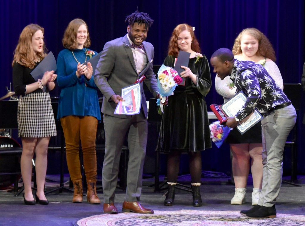 Poetry Out Loud runner-up Allan Monga, right, of Deering High School in Portland, bows to winner Joao Victor of Lewiston High School after the state final held at the Waterville Opera House on Monday. Other participants, from left, are Emily Campbell of Waterville Senior High School, Hanna Lavenson of Messalonskee High School, Magnolia Vandiver of George Stevens Academy in Blue Hill and Aaliyah Biamby of Gorham High School.
