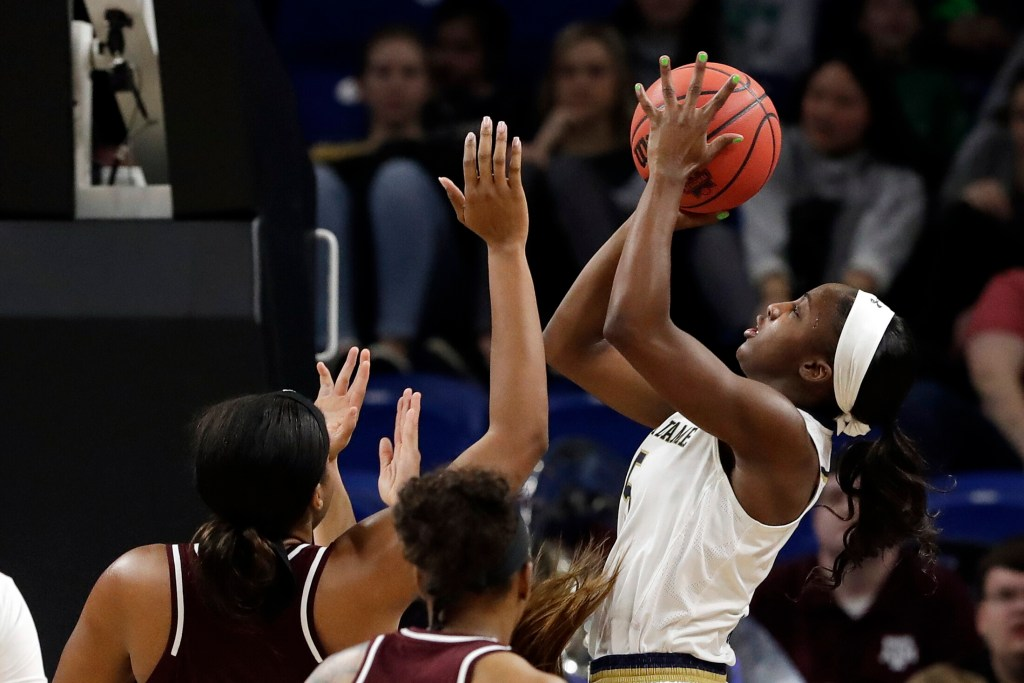 Notre Dame's Jackie Young goes up for a shot in the first half of a regional semifinal Saturday against Texas A&M. Notre Dame, the defending national champion, advanced to the Elite Eight with an 87-80 win.