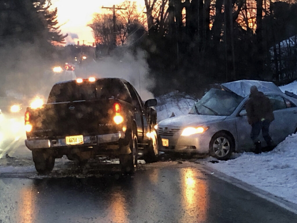 Westbrook police have asked for potential eyewitnesses to Monday morning's fatal crash on County Road to come forward. They say this photo, taken by a witness seconds after the crash, shows an unknown man standing at the driver's window of the taxi in which three men died.