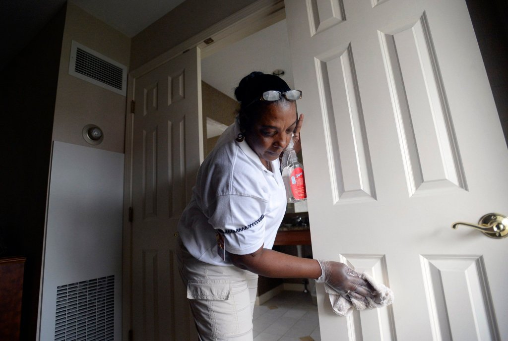 Merlene Warren of Montego Bay, Jamaica cleans a guest room at the Meadowmere Resort in Ogunquit on June 12, 2013. Warren was working temporarily in the U.S. with an H-2B Visa.