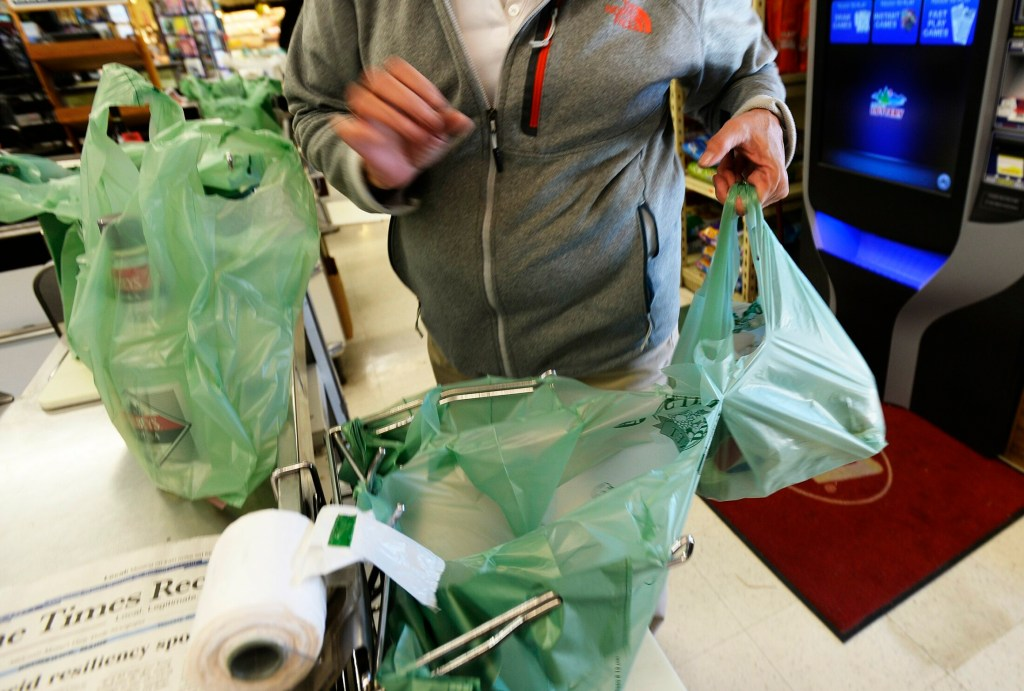 Plastic shopping bags such as these would no longer be allowed in most Maine stores if Gov. Janet Mills signs a bill banning them.