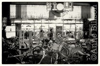 Bicycles in front of pachinko parlour.