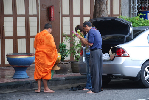 Monk Alms via Flickr CC by Denis'Life