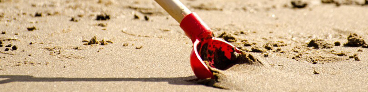Red Shovel in the Sand