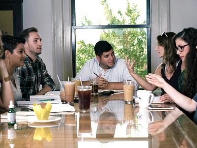team meeting around table