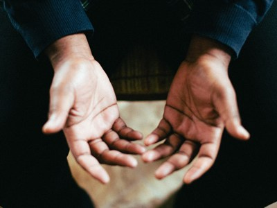 Hands open receiving prayer