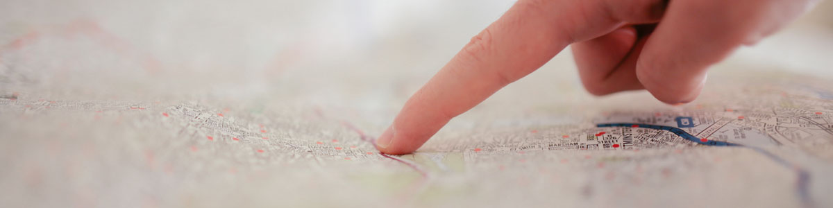 Person pointing at map
