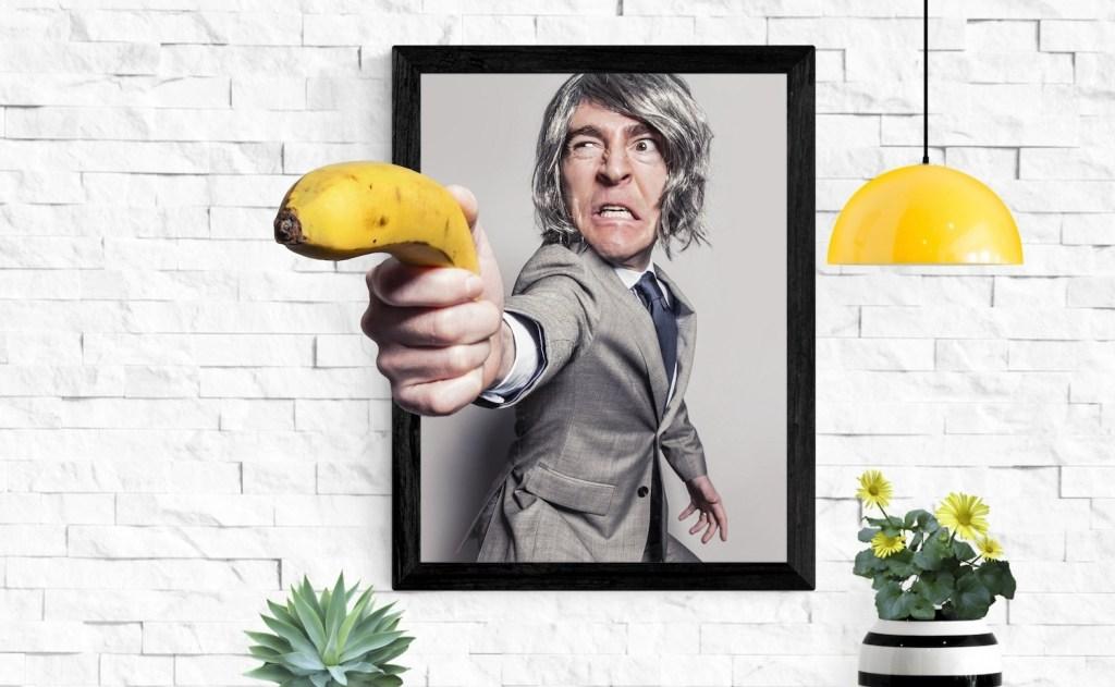 Man pointing banana