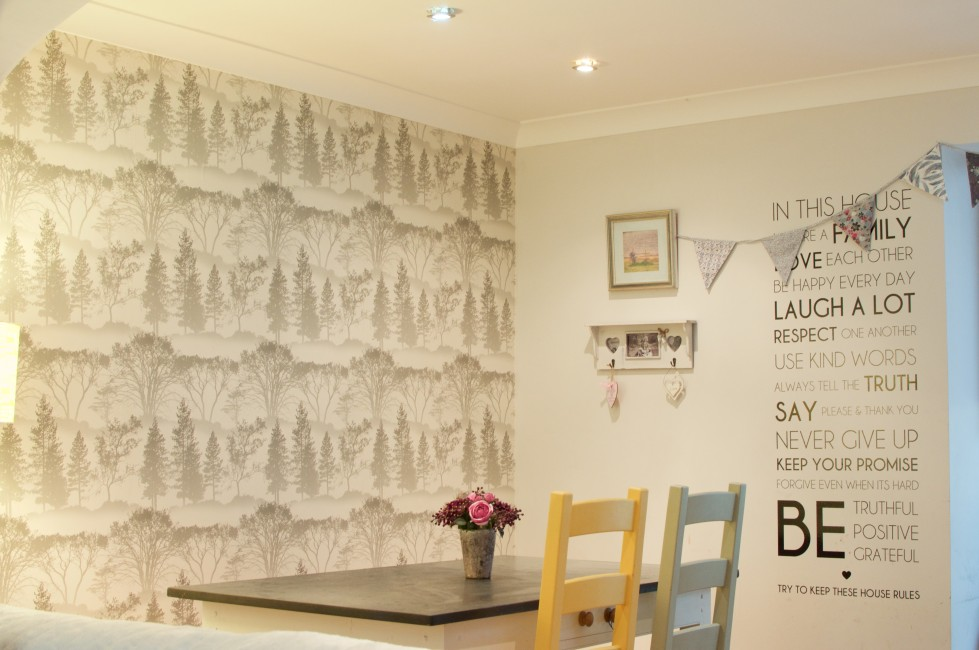 Using wall paper as feature wall in a grey and yellow dining room makeover