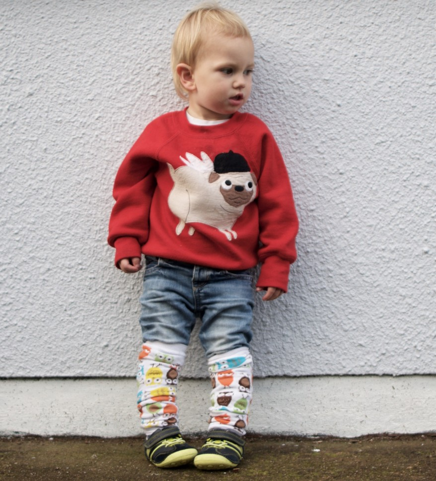 Keeping toddlers warm in winter. These funky leg warmers are perfect for baby wearing sling walks.