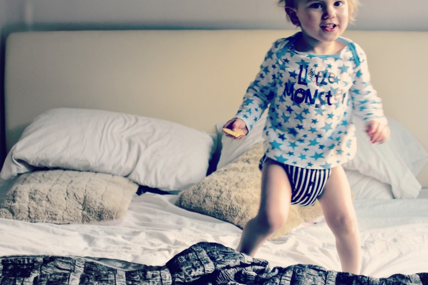 Living arrows; one little monkey jumping on the bed