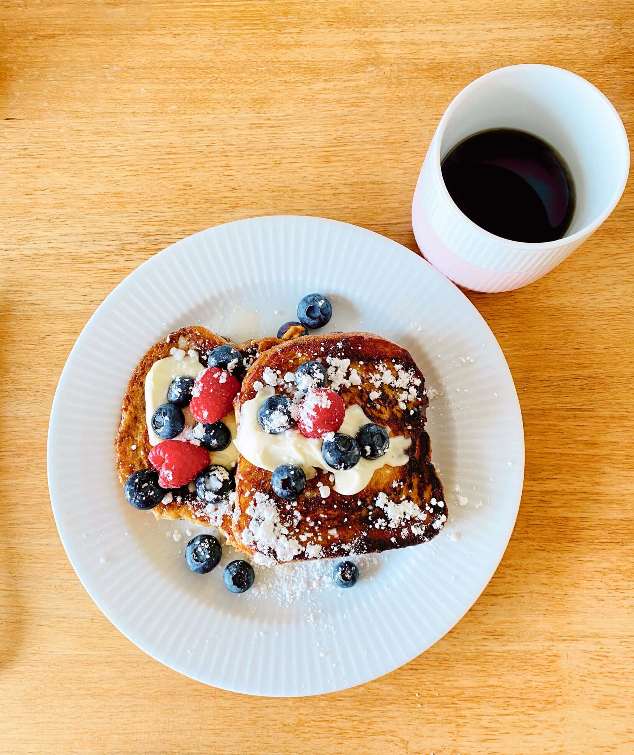 Julies french toast with berries and a cup of coffee