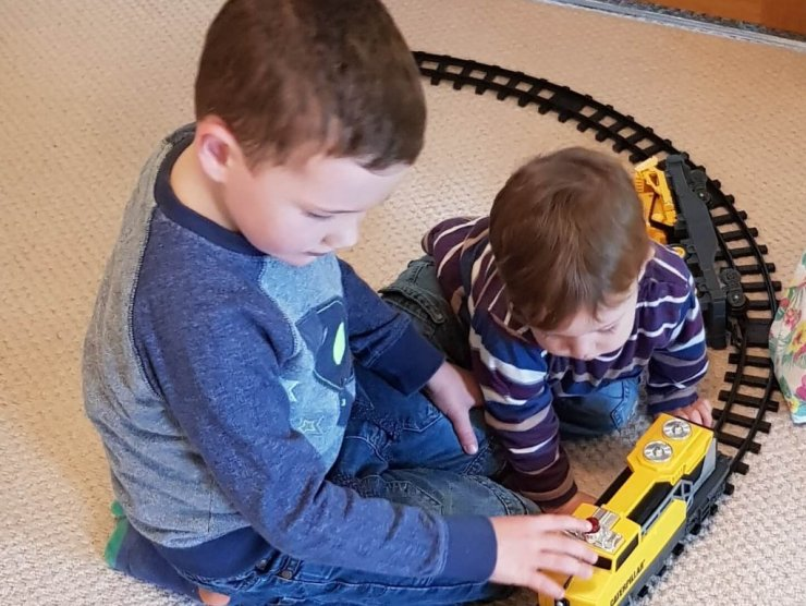 boys-playing-with-toy-train-set