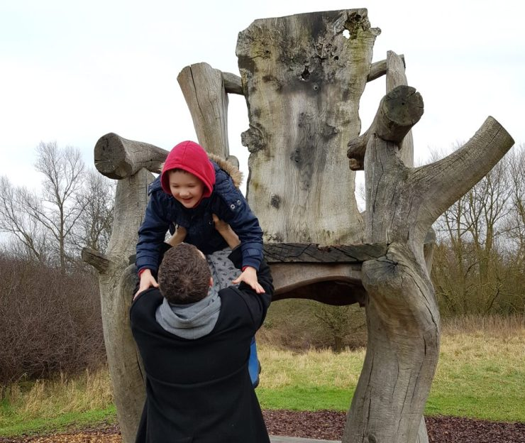 boy-being-helped-off-giant-chair-by-daddy