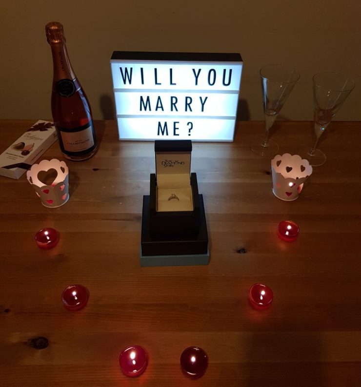 candles-champagne-ring-in-a-box-lightbox-saying-will-you-marry-me