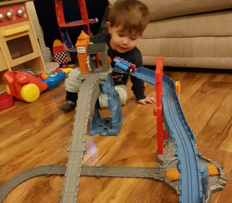 toddler-playing-with-thomas-train-track
