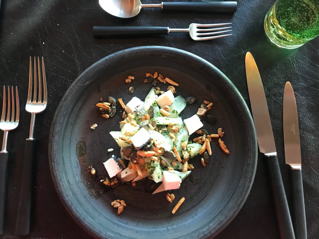 A salsify and goats cheese sald with caramelised nuts and seeds