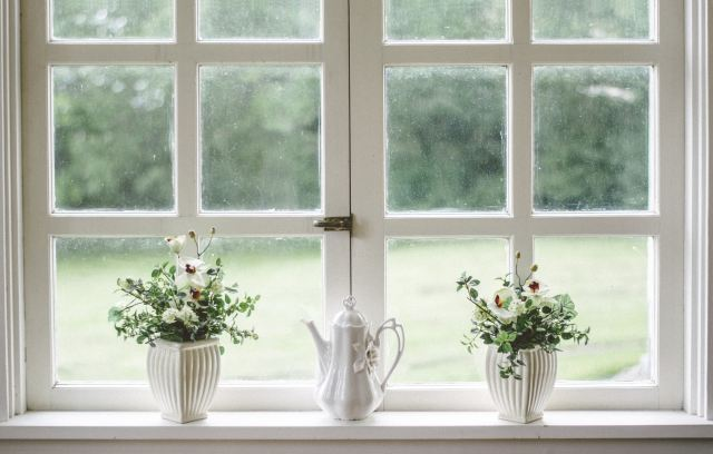 make your window space lovely by adding ornaments like these, this picture is of a window with flowers and a jug on it