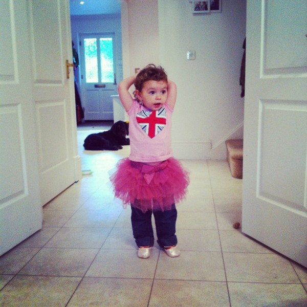 Little Girl Dancing In Her First Ballet shoes