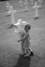 My daughter hugging the graves at Omaha