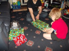 Wriggler joining in with the birthday spirit and helped wrap Bruiser's birthday presents!