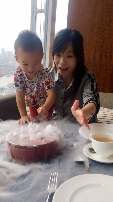 Toddler fascinated with Dry Ice