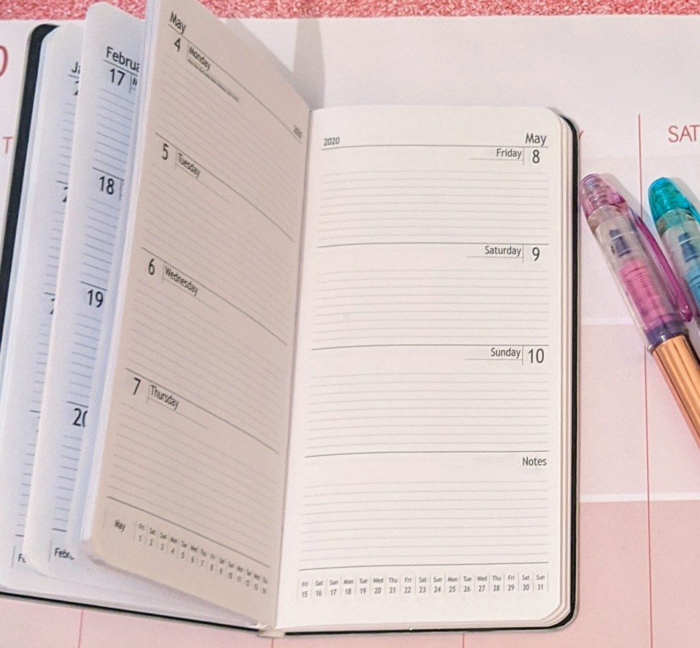 Inside the slimline planner and two highlighters on the side nearly out of shot
