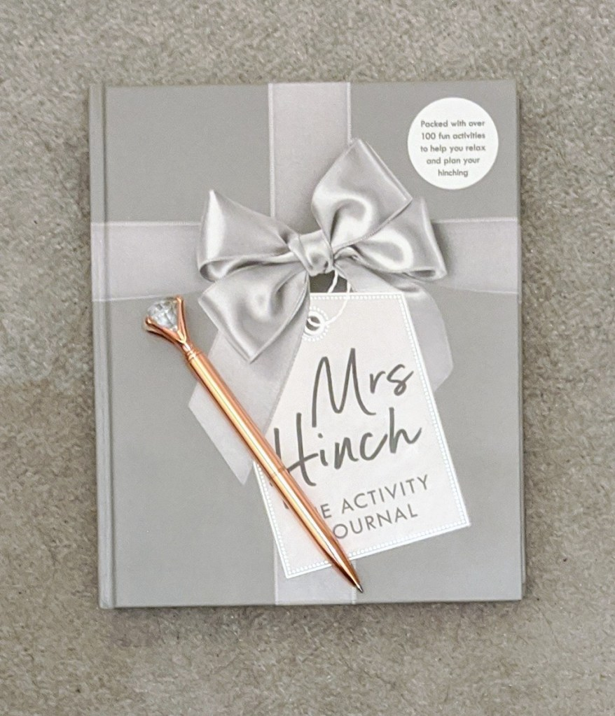 Mrs Hinch cleaning planner with a gold pen on top