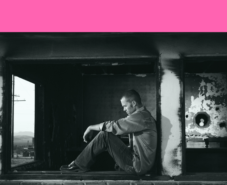 Man sitting alone in black and white