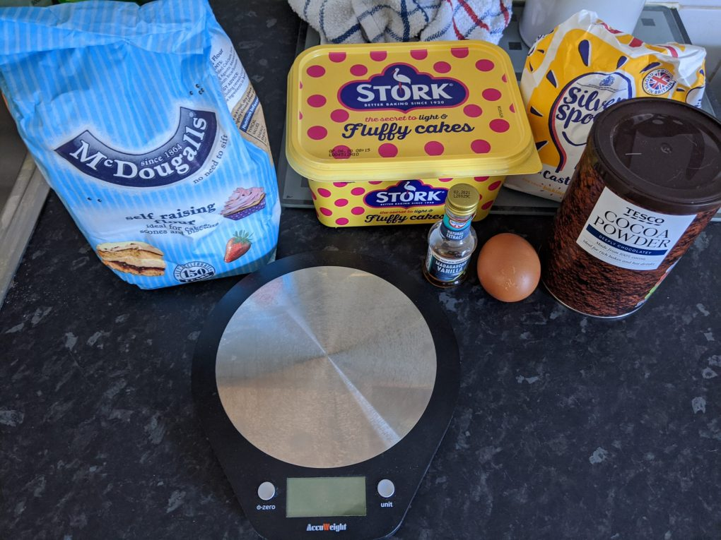 Scales, flour, butter, egg and other ingredients needed for chocolate crunch