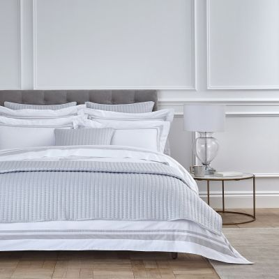 Double bed with grey and white bedding