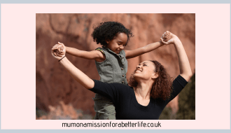 Woman supporting her child on her shoulders