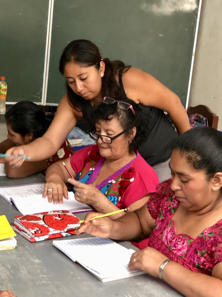 adult literacy students and teacher