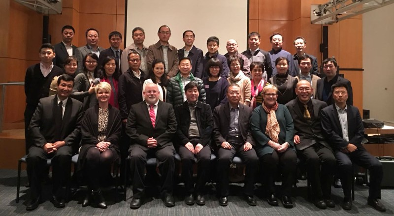 Marie Domenech and Brad Lint (front row, second and third from left) with delegates at AASCU meeting.