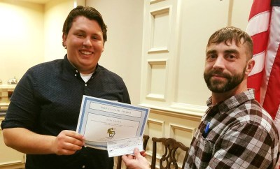 Josh Grassi (Left) accepts the Cooper Award from Tim Wertz, president of the Pennsylvania Chapter of the American Fishery Society.