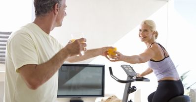 passing-orange-juice-to-wife-cycling-at-home.JPG
