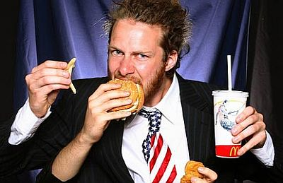 eating-fries-burger-drinking-soda-with-four-hands.jpg