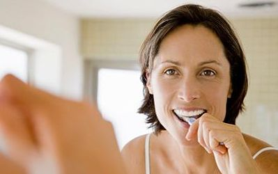Woman-Brushing-Teeth-In-Morning.jpg