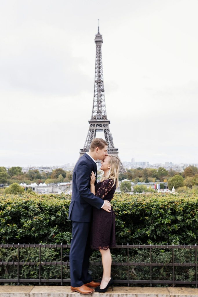 couple photo in front of eiffel tower in October