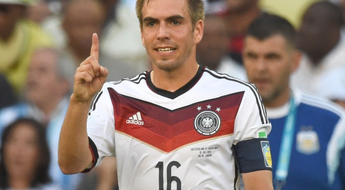 Philipp Lahm of Germany gestures during the FIFA World Cup 2014 final soccer match between Germany and Argentina at the Estadio do Maracana in Rio de Janeiro, Brazil, 13 July 2014. Photo:Marcus Brandt/dpa (RESTRICTIONS APPLY: Editorial Use Only, not used in association with any commercial entity - Images must not be used in any form of alert service or push service of any kind including via mobile alert services, downloads to mobile devices or MMS messaging - Images must appear as still images and must not emulate match action video footage - No alteration is made to, and no text or image is superimposed over, any published image which: (a) intentionally obscures or removes a sponsor identification image; or (b) adds or overlays the commercial identification of any third party which is not officially associated with the FIFA World Cup) EDITORIAL USE ONLY