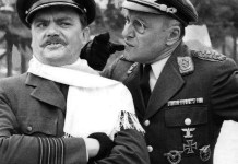 Bernard Fox as Captain Critterton and Werner Klemperer as Commandant Klink from the television program Hogan's Heroes.