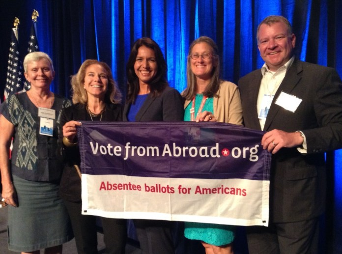 (Gary Suwannarat, all the way on the left, is joined by fellow DNC members Caitlin Craft-Buchman and John Eastwood, and International Chair Katie Solon, reminding Americans overseas to Vote From Abroad)