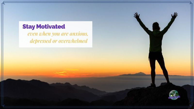 "man on mountain with arms raised and text overlay ""Stay Motivated even when you are anxious, depressed or overwhelmed"""