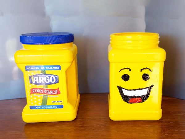 Lego minifig head from cornstarch container