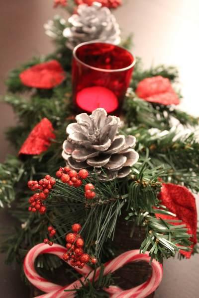 greenery with red candles and candy canes
