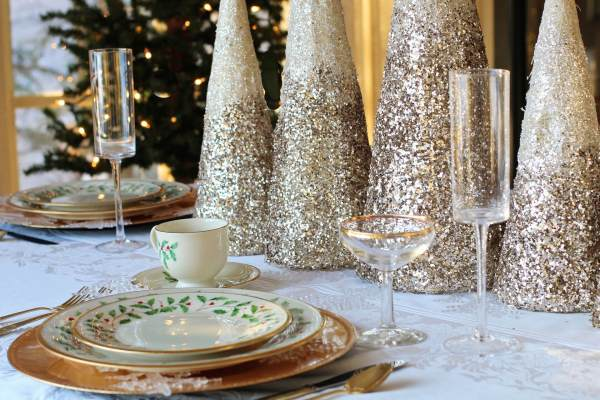 gold glitter trees on Christmas dinner table
