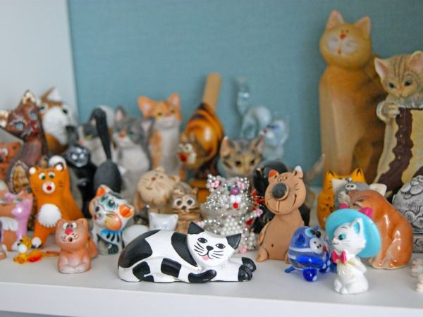 a collection of cat figurines