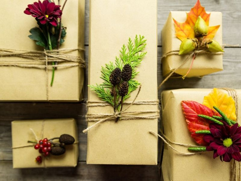 gifts wrapped in brown paper with string