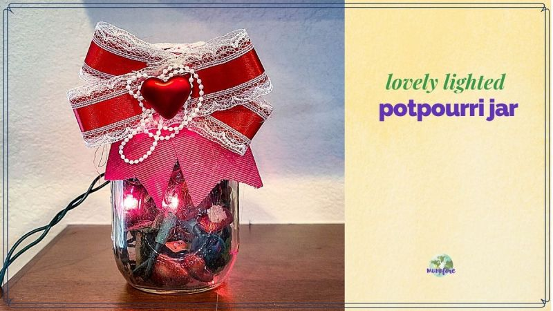 "mason jar filled with potpourri and christmas lights with text overlay ""lovely lighted potpourri jar"""